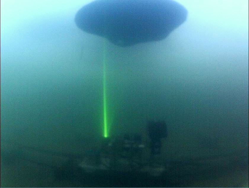 Underwater sensors including cameras, sonar, and laser fluorescence are used to detect oil under ice at the Cold Regions Research and Engineering Laboratory.