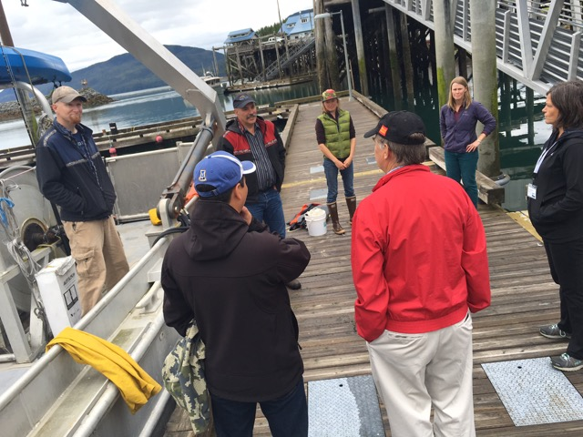 On the dock, learning how to throw a cast net. Photo credit: Aleesha Towns-Bain