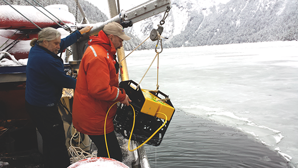 David Janka and Scott Pegau retrieve the ROV in Beartrap Bay after working with it under the ice.