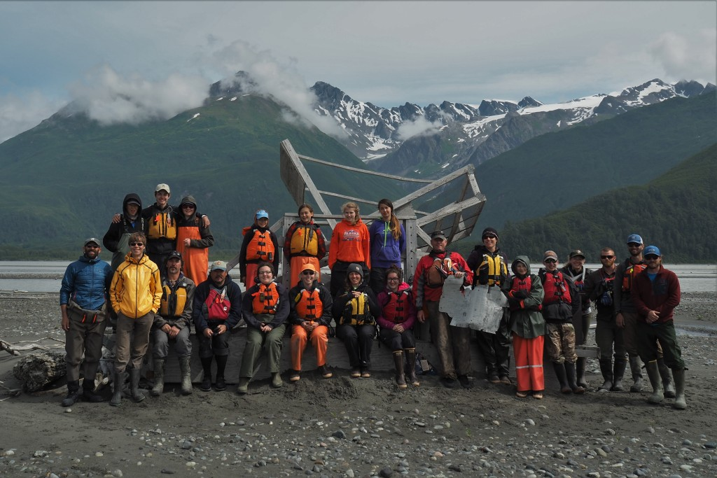 Students, educators, and rowers pose in front of an escaped fish wheel along the banks of the Copper River. Back Row: Elias Hanson, Arctic Buchanan, John Appleton, Ria Smyke, Anika Witsoe, Nikki Friendshuh, Alexis Hutchinson; Front Row: Scott Hickox, Flynn Milligan, Eric Lutz, Glenn Hart, Akilena Veach, Helen Laird, Lauren Bien, Zoe Russin, Barry Whitehill, Kate Morse, Faith Collins, Thomas Abraham, Carolyn Venner, Luke Wassink, Ryan Chalker, Tim Skiba Photo credit: Flynn Milligan